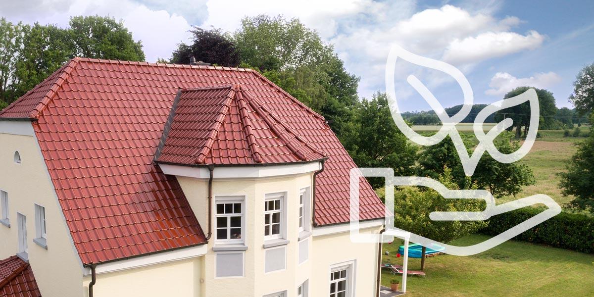 Umweltschonend - Natur und Umwelt: -Referenzobjekt mit roten Laumans Dachziegeln